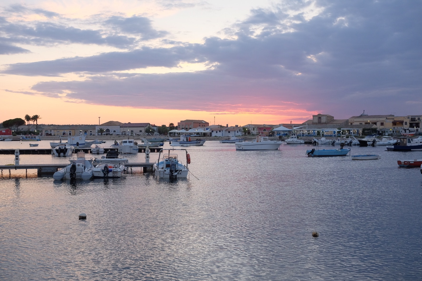sunset at the harbour in Marzamemi