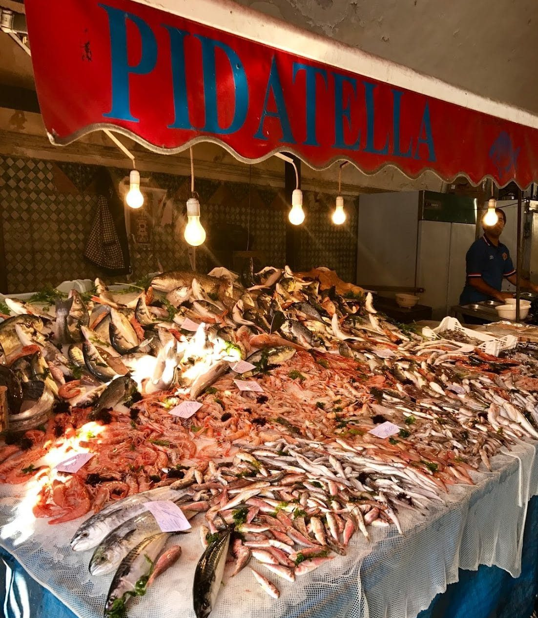 fresh fish displayed with great effort at Catania fish market