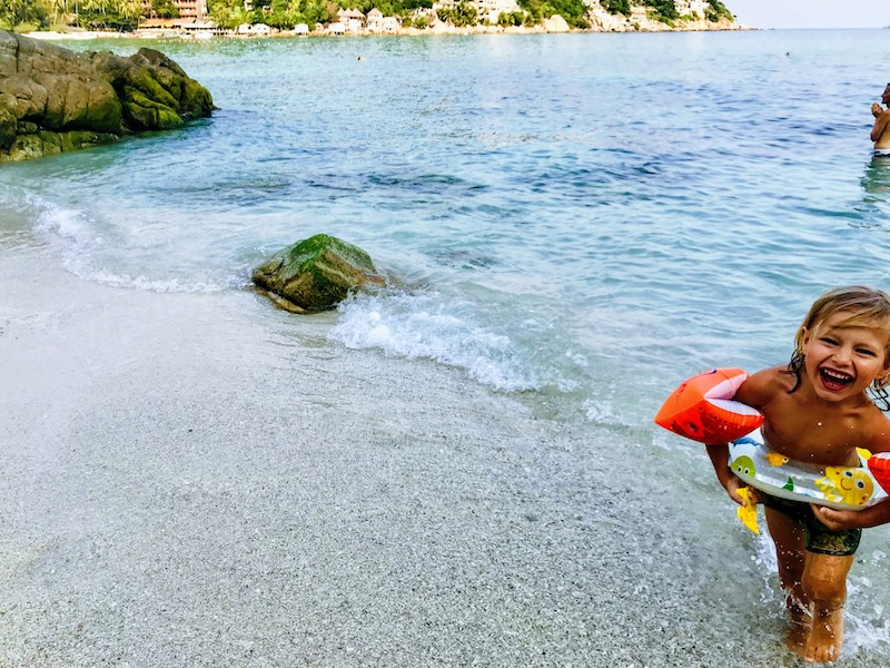 Kid Playing on the beach at Shark Bay on Koh Tao