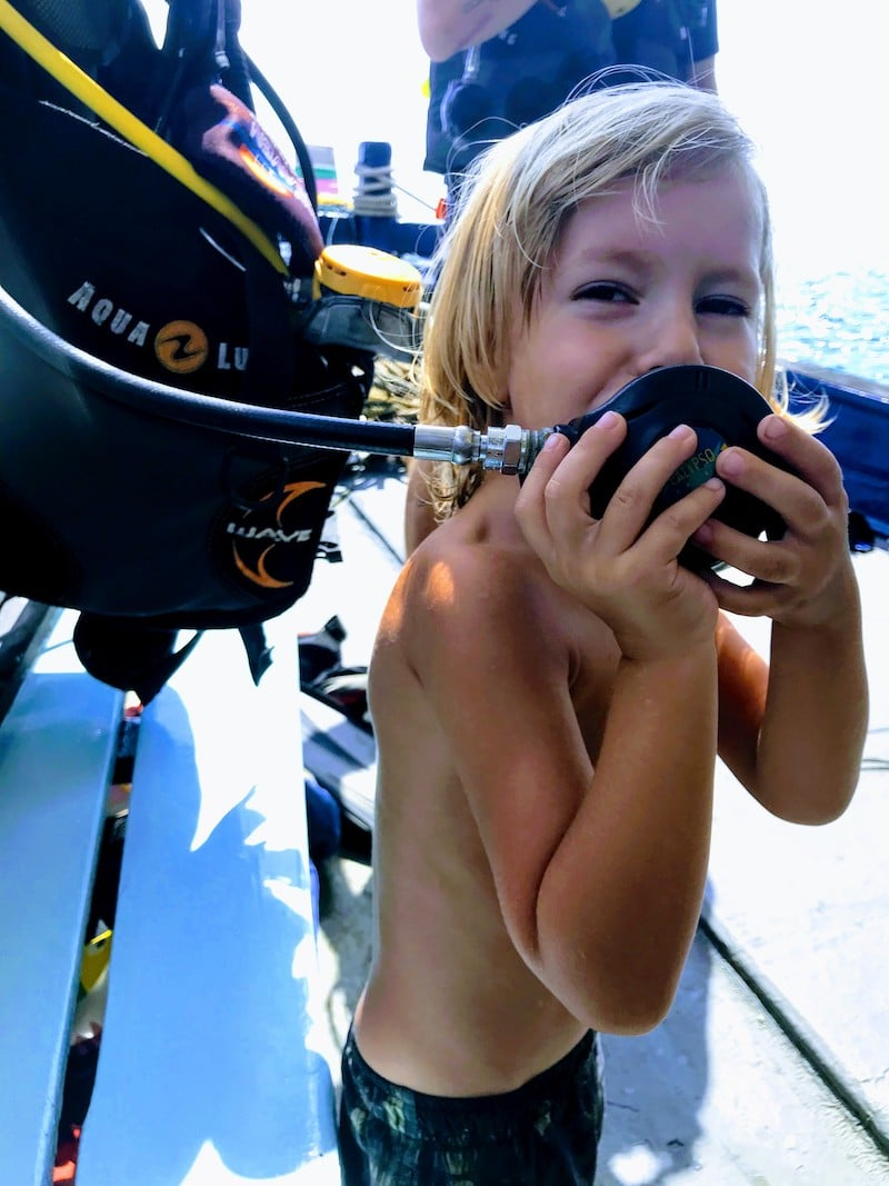 Kid trying diving regulator at Koh Tao