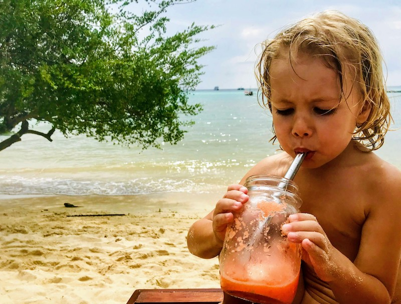 Smoothie drinking on beach Ko Tao
