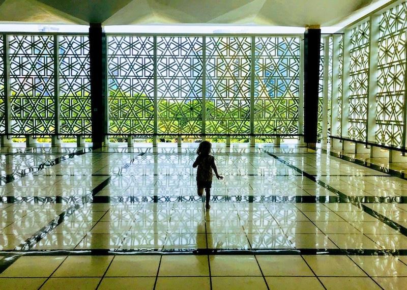 Running inside the huge Masjid Negara Mosque Kuala Lumpur