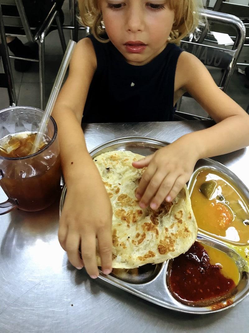 Kid eating Roti
